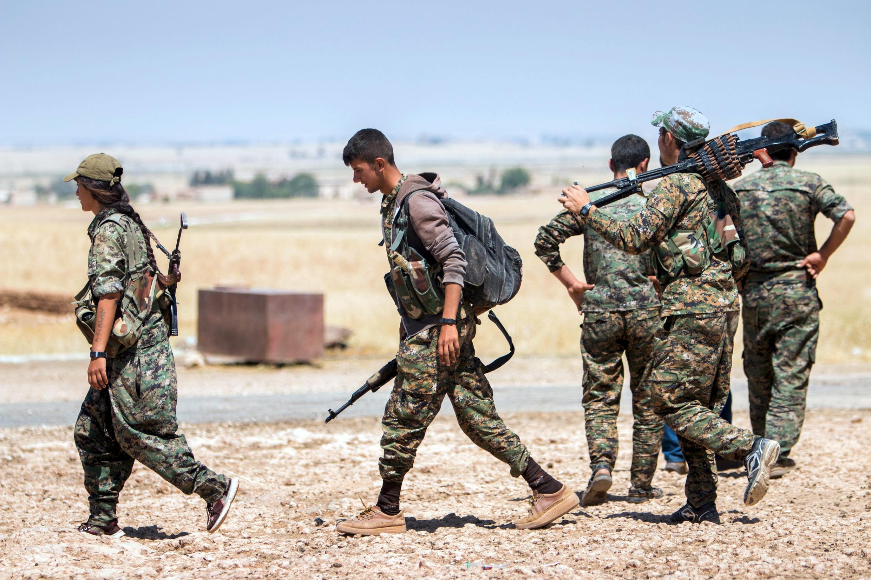 Курдские бойцы в Сирии