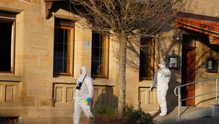 Forensic experts leave the house after several people were injured and some presumed dead in a shooting in Rot am See in southwestern Germany, January 24, 2020.
