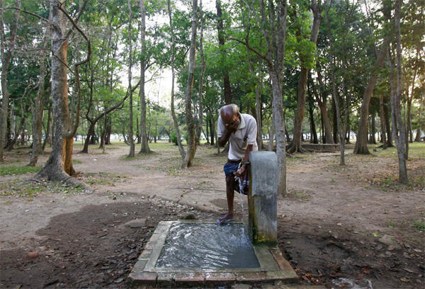 A homeless man washes his face in Colombo, Sri Lanka on 22 March. World Water Day is highlighting the fact that more than a billion people lack access to clean water