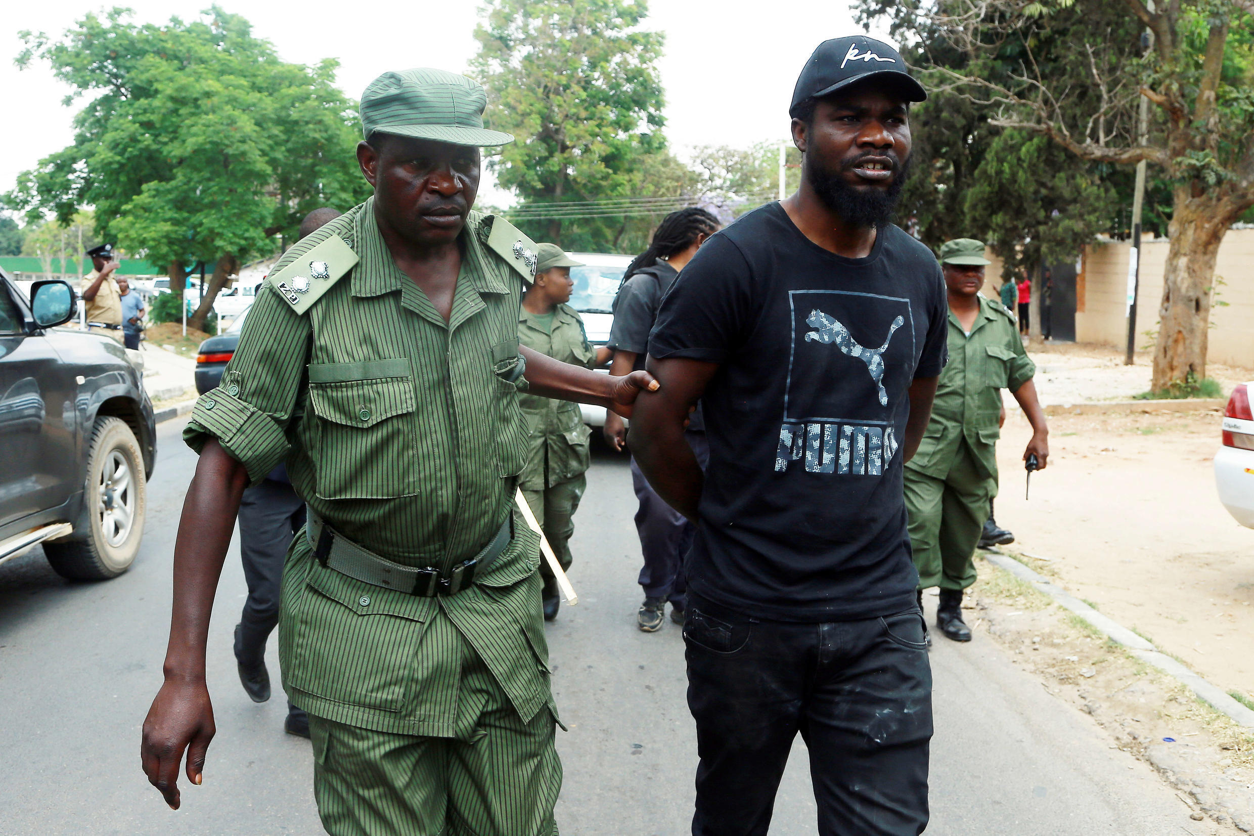 Pilato is arrested during a protest march in Lusaka on 29 September 2017.