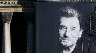 A giant poster of late French singer and actor Johnny Hallyday is displayed on the facade of the Madeleine Church during a 'popular tribute' in Paris, France, December 9, 2017.