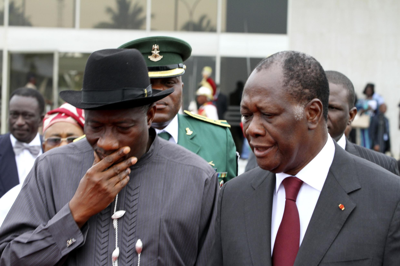 Côte d'Ivoire and Ecowas President Alassane Ouattara talks with Nigeria's President Goodluck Jonathan