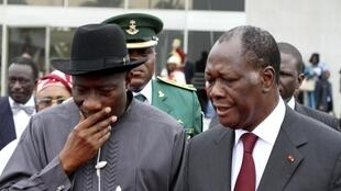 Côte d'Ivoire and Ecowas President Alassane Ouattara talks with Nigeria's President Goodluck Jonathan