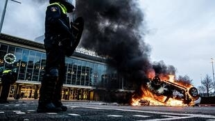 Police fired tear gas in the southern city of Eindhoven, where looting was reported