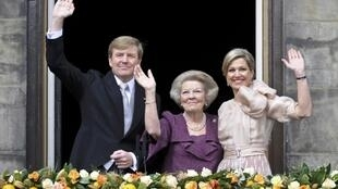 Princess Beatrix of Netherlands with her son, King Willem-Alexander and his wife Queen Maxima at the Royal Palace in Amsterdam 30 April, 2013