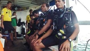 Recruits for Cambodia's first underwater UXO salvage team get ready to dive during training