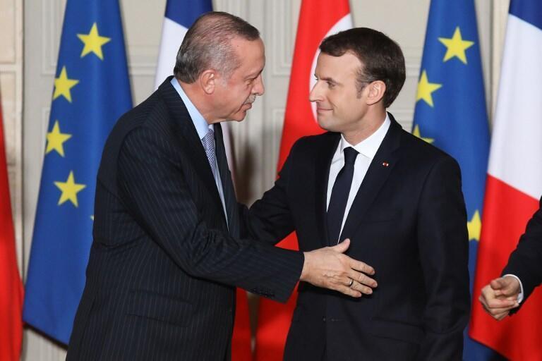 French President Emmanuel Macron (R) and Turkish President Recep Tayyip Erdoganin Paris in January