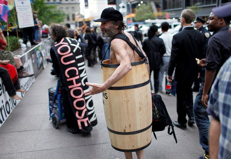 An Occupy Wall Street protestor wears a wooden barrel in Zuccatti Park in New York