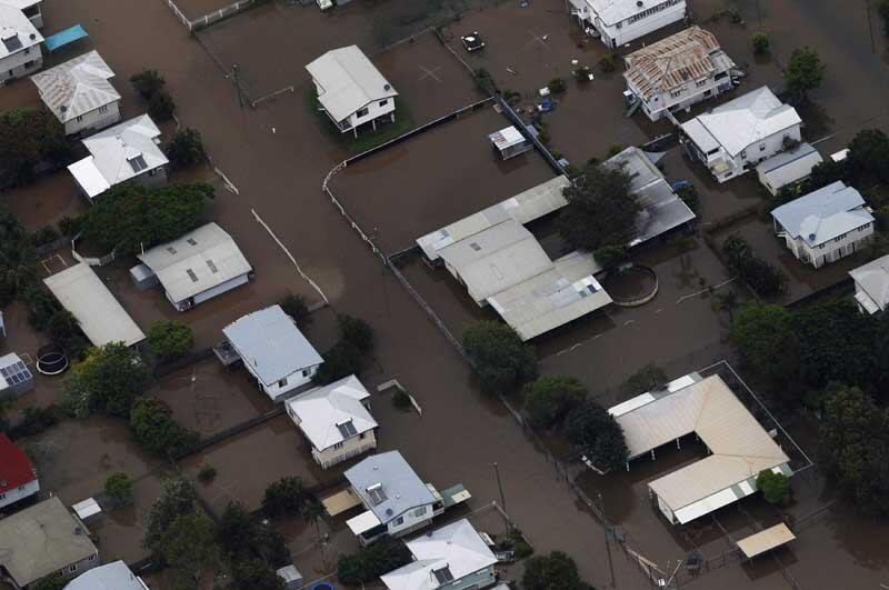 Buildings are submerged in floodwaters in a neighbourhood in Rockhampton