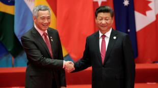 Chủ tịch Trung Quốc Tập Cận Bình đón thủ tướng Singapore Lý Hiển Long (T) tại Thượng đỉnh G20 ở Hàng Châu (Trung Quốc), ngày 4/09/2016.