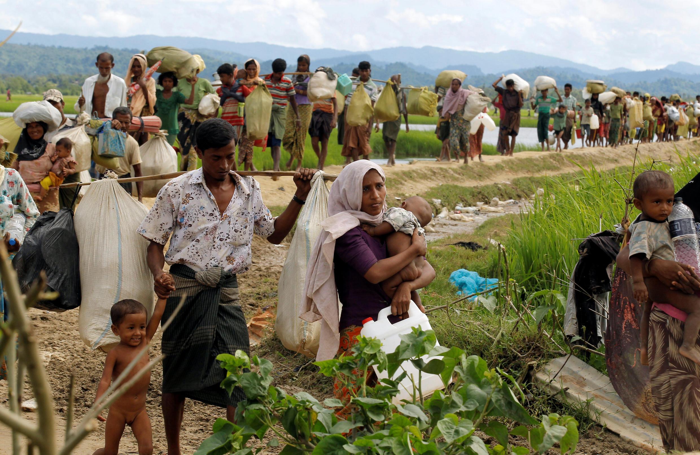 Rohingya refugees walking from Myanmar into neighbouring Bangladesh - october 2017