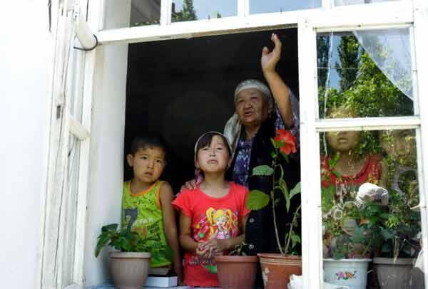 An ethnic Uzbek family at the window of their house in Bazar-Korgon, 20 km from Jalalabad.