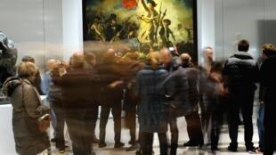 """Facebook reconhece erro por censurar os seios nus da tela """"A Liberdade guiando o povo"""". Museu do Louvre."""
