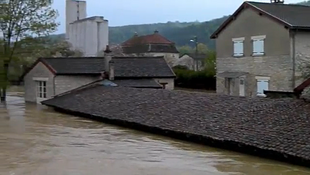 Flood waters reach the roof of a building in a village near the eastern town of Troyes