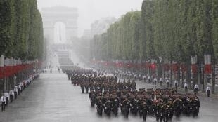 The Bastille Day parade braves the rain
