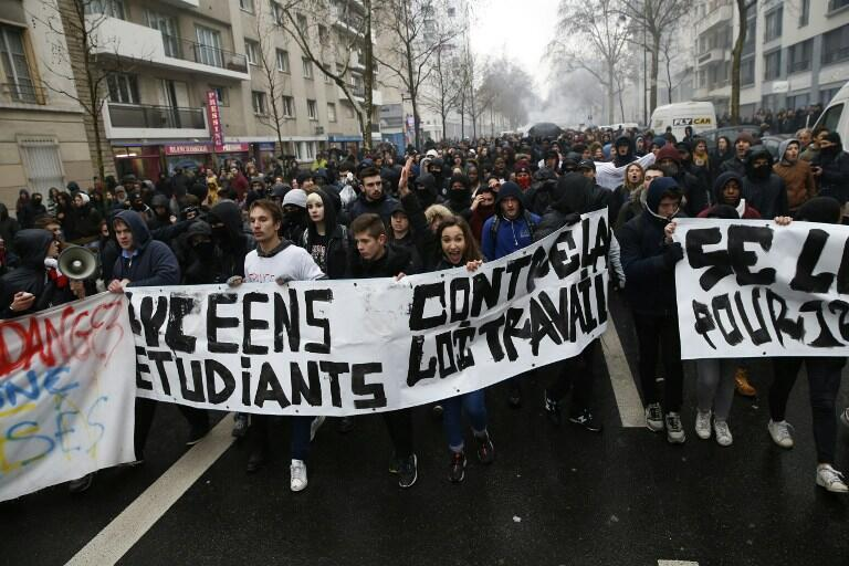 Students march near Place de la Nation in Paris to protest the government's planned labour reforms.