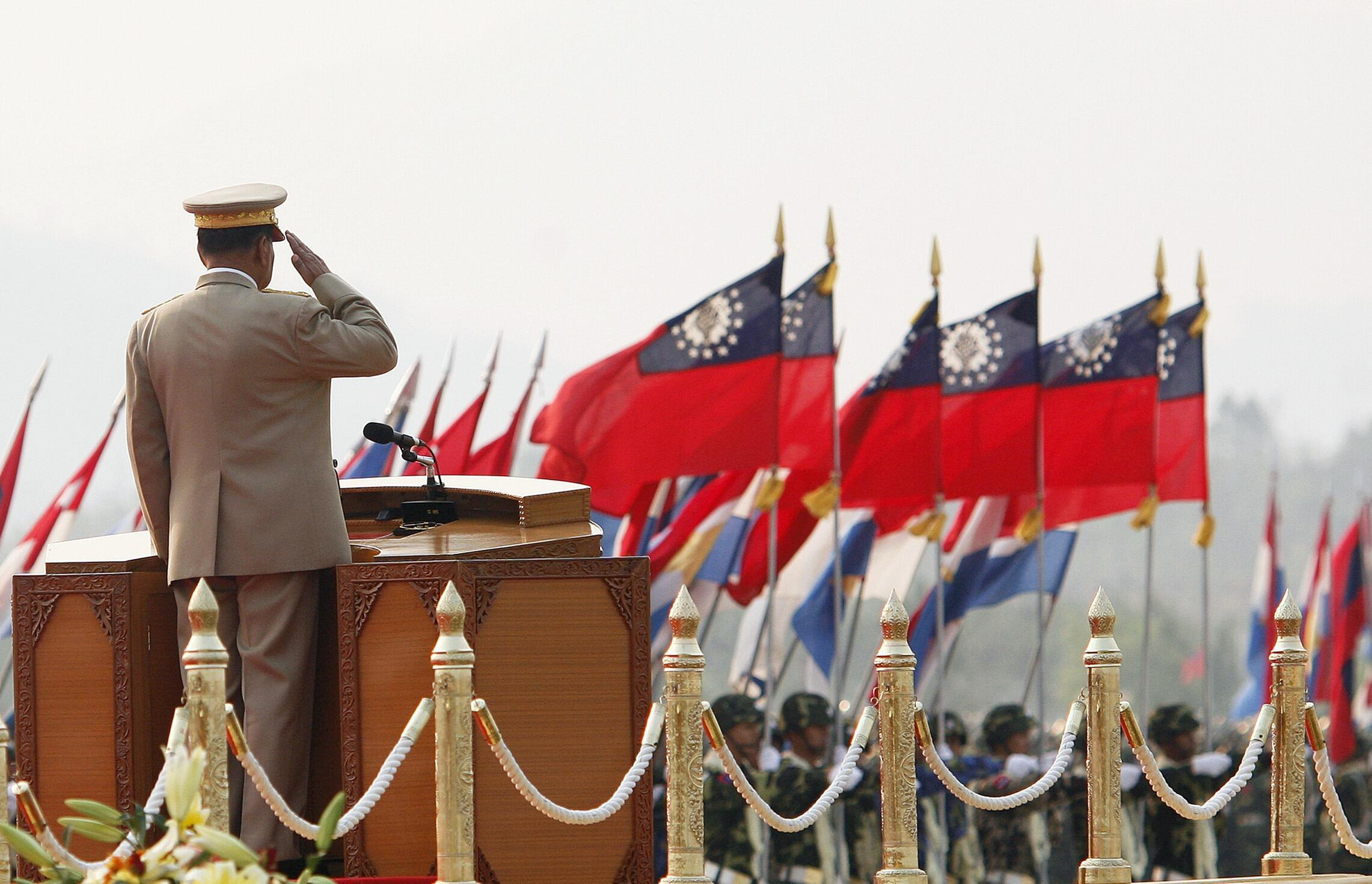Myanmar's junta supremo Senior General Than Shwe salutes during the Armed Forces Day parade in Myanmar's capital Naypyidaw