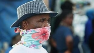 A man protecting his face against Covid-19 with a homemade mask in South Africa.