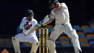 Australia captain Steven Smith plays a shot on the third day of the first Test match against Pakistan at the Gabba on Saturday.
