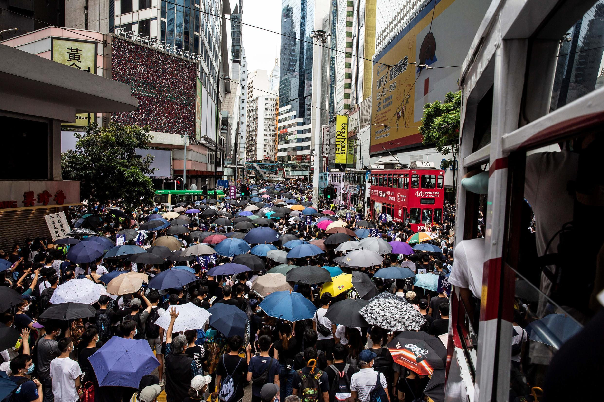 Pro-democracy protesters gather in the Causeway Bay district of Hong Kong to rally against Beijing's plan to introduce new security legislation in the city