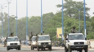 Soldiers from Mali's ruling junta drive through the streets after overrunning the main presidential guard barracks