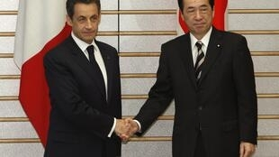 French President Nicolas Sarkozy is greeted by Japan PM Naoto Kan on a visit Thursday
