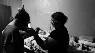 Nine-year-old Davi and Cintia, residents of Manaus; both infected with coronavirus and struggling to pay for oxygen to keep the boy alive.