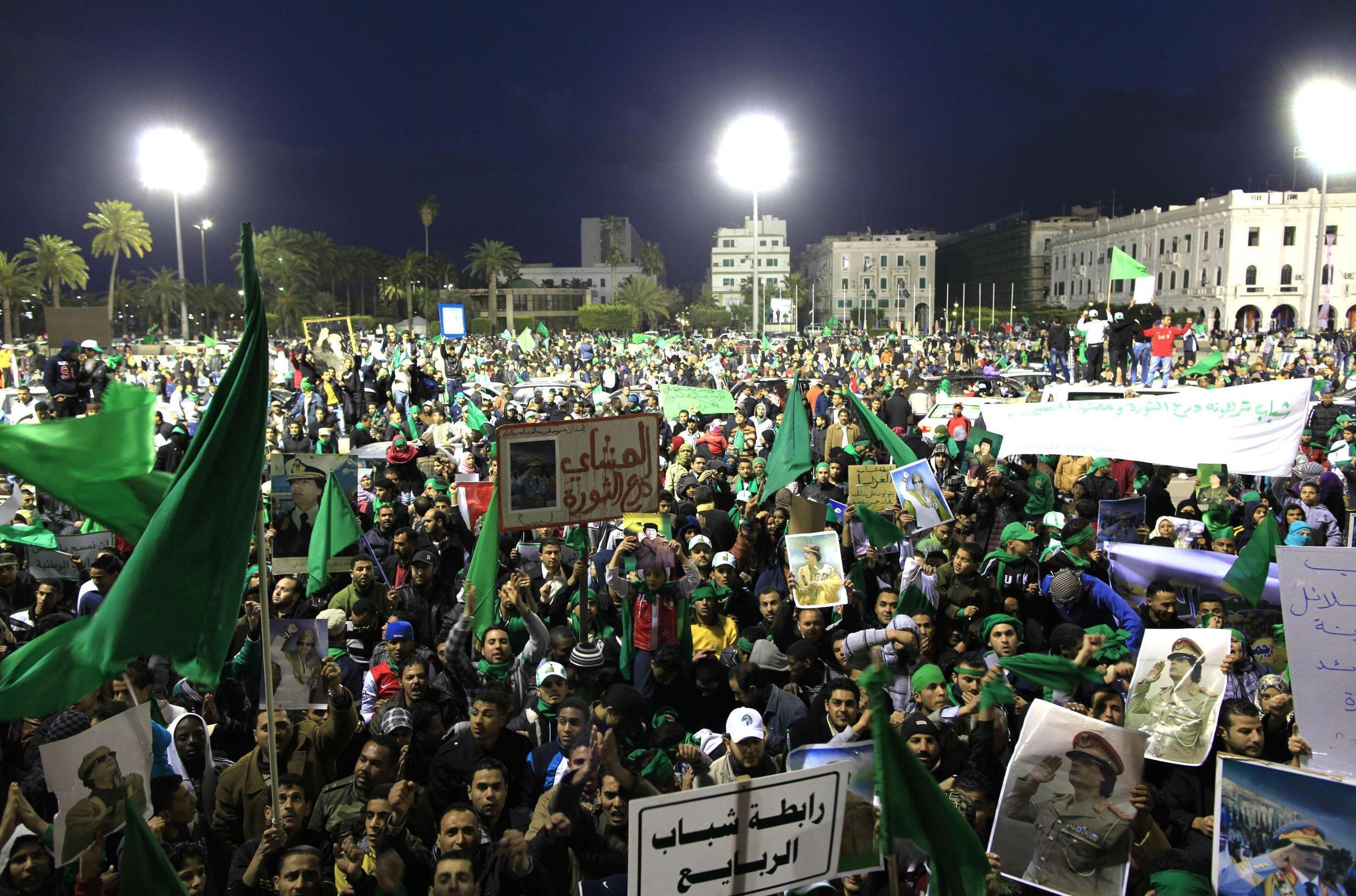 Supporters of Libyan leader Moamer Kadhafi chant slogans at the Green Square 25 February 2011.