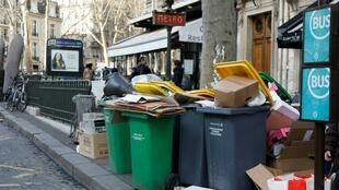 Overflowing trash bins in Paris, 4 February 2020, as waste incineration plants go on strike against the government's pension reform.