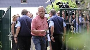 Investigators arrive at an organic farm in Germany on Monday
