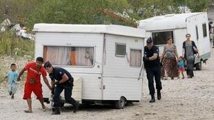 French police clear a camp near Lyon on Tuesday