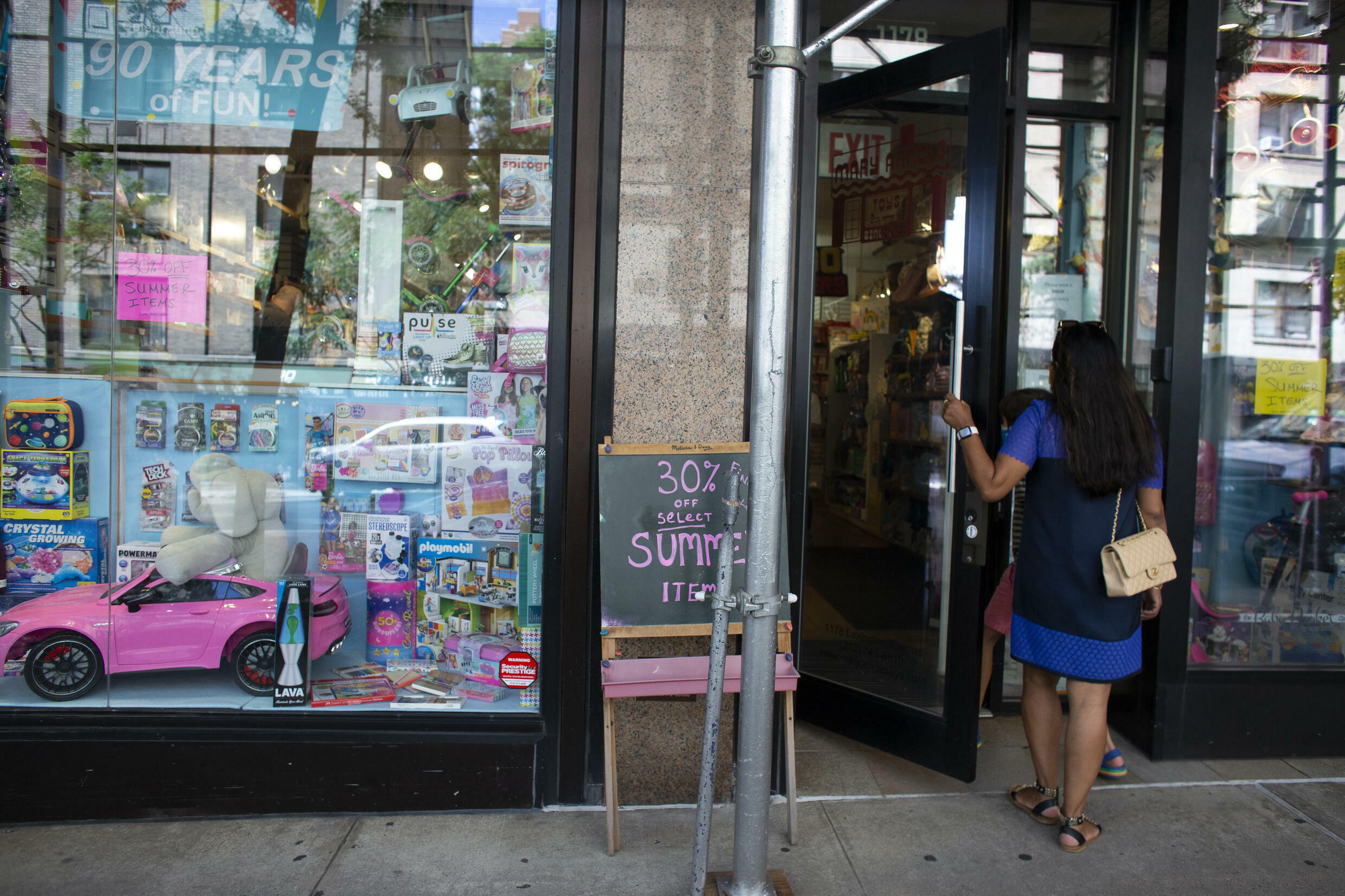A shopper enters Mary Arnold Toys in New York on August 2, 2021
