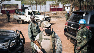 The United Nations Security Council has asked all forces in the Central African Republic to guarantee the safety of UN peacekeepers -- one is seen at right in 2020 in the capital Bangui