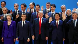 Les dirigeants du G20 réunis à Buenos Aires, en Argentine, vendredi 30 novembre 2018. Une fois n'est pas coutume, Angela Merkel n'a pas pu se rendre sur place en temps et en heure.