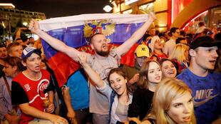 Russian fan holds national flag as he celebrates after the match on June 20.