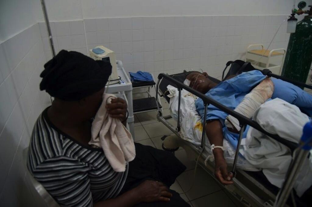 Mmoja wa waathirika wa ajali iligharimu maisha ya watu 38 na kujeruhiwa 13 katika mji wa Gonaives (Haiti) wakati basi lililpogonga umati wa watu.