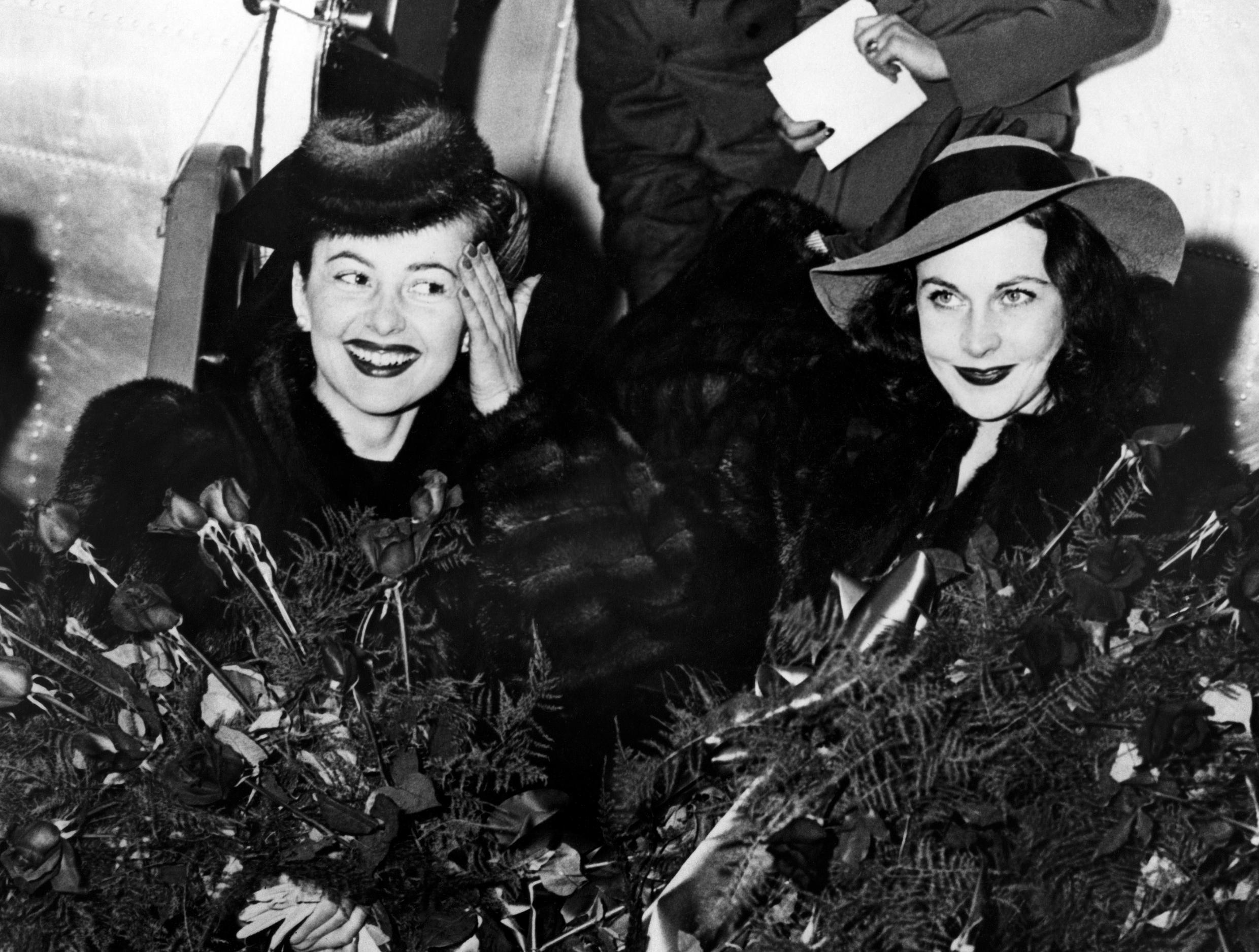 Olivia de Havilland (L.) with British actress Vivien Leigh, her co-star in Gone with the wind
