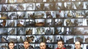 Các quan sát viên theo dõi cuộc bầu cử tổng thống Nga tại trụ sở chính của Ủy Ban Bầu Cử Trung Ương Nga tại Mátxcơva (Nga) ngày 19/03/2018.