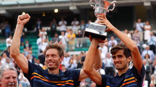 Nicolas Mahut (left) and Pierre-Hugues Herbert must win their doubles match against Mate Pavic and Ivan Dodig to maintain their country's hopes of an 11th Davis Cup title.