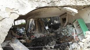 Burnt newspaper copies are seen in the rubble of a destroyed This Day newspaper building in Abuja, 28 April, 2012
