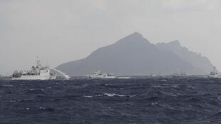 A Taiwanese Coast Guard ship fires water cannons near the disputed East China Sea islets