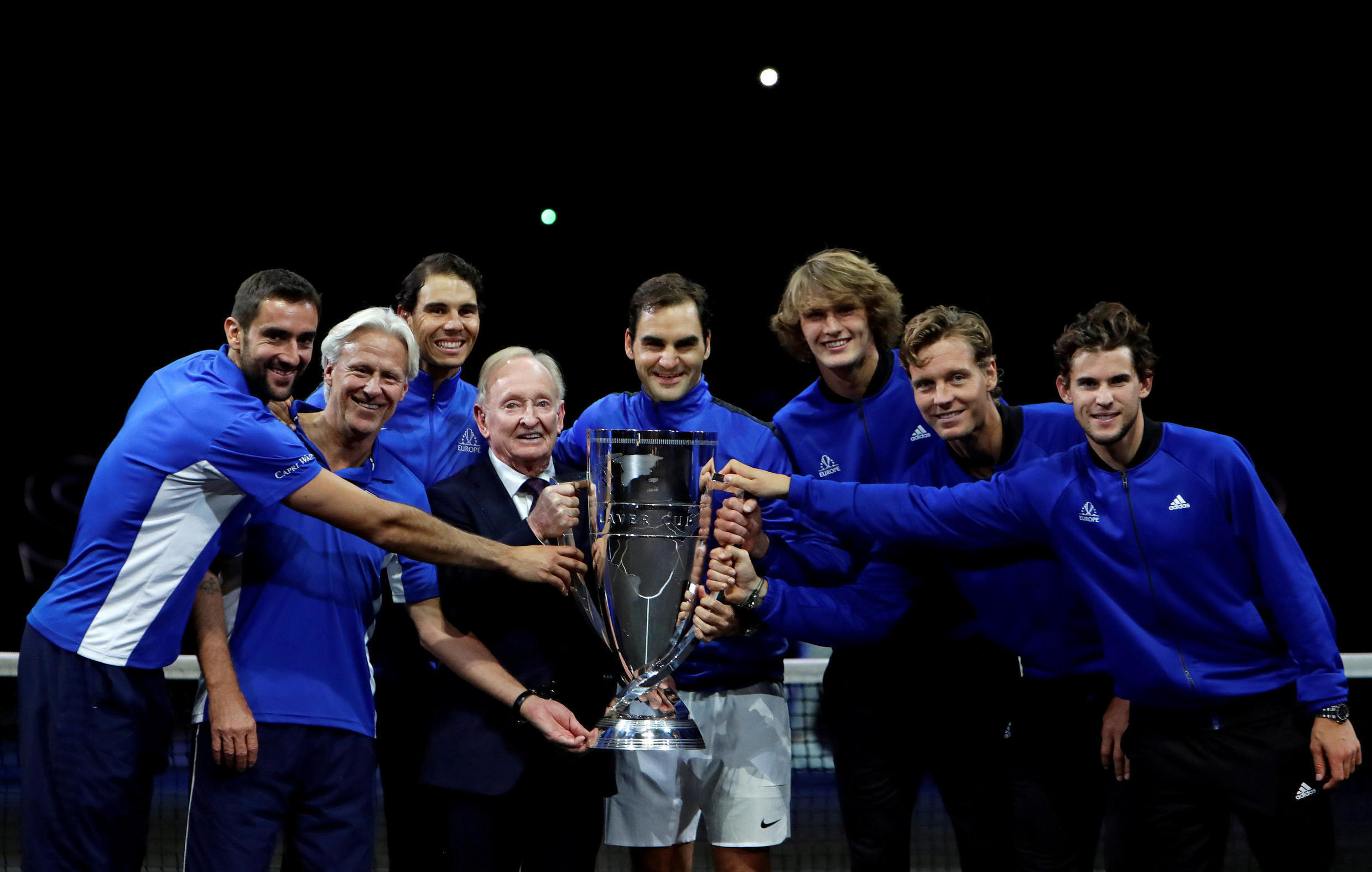 Members of Team Europe celebrate with Rod Laver after winning the competition named in his honour.