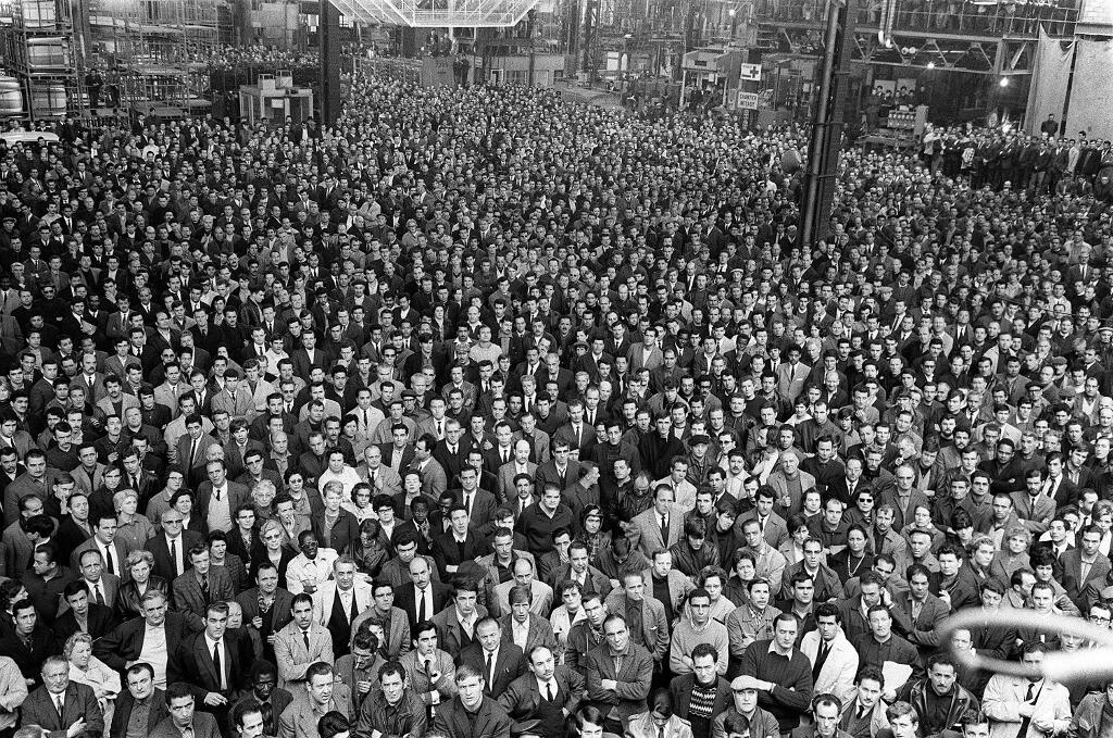 Striking workers at Renault car factory in Boulogne-Billancourt listen to CGT trade unionist speech on 17 mai 1968.