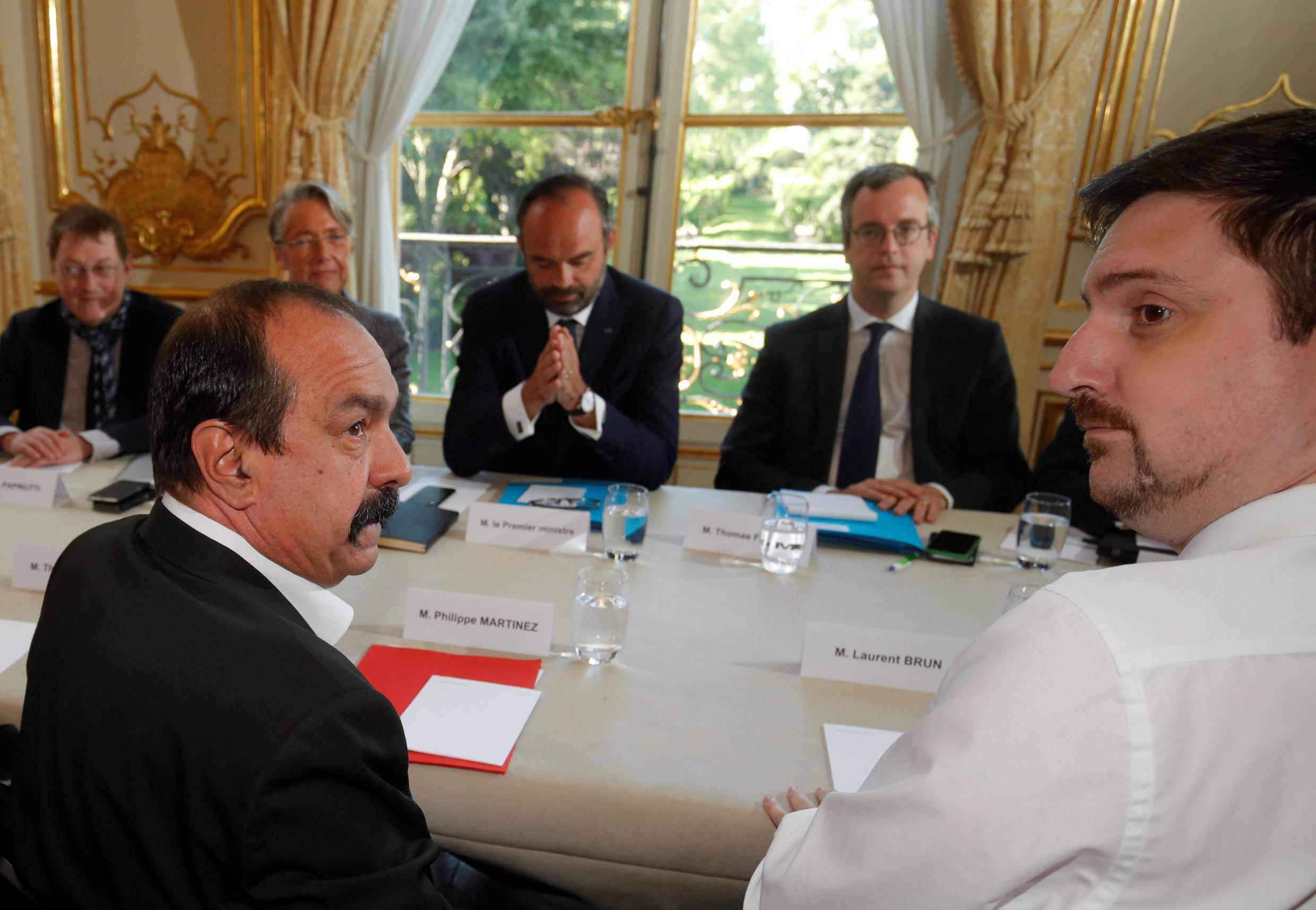 French CGT labour union leader Philippe Martinez (L) and Laurent Brun (R), head of the CGT's railway section, arrive for a meeting with French Prime Minister Edouard Philippe at the Hotel Matignon in Paris, France, May 7, 2018.