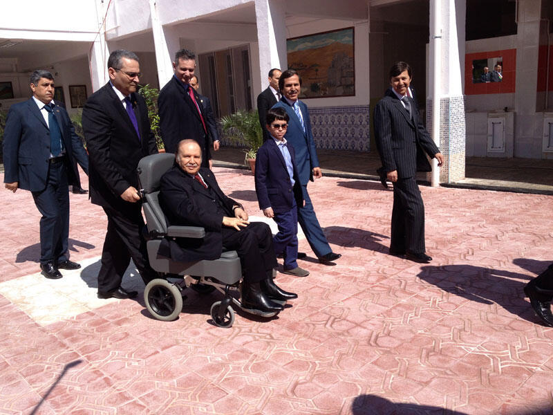 Abdelaziz Bouteflika is wheeled into the polling station to cast his vote