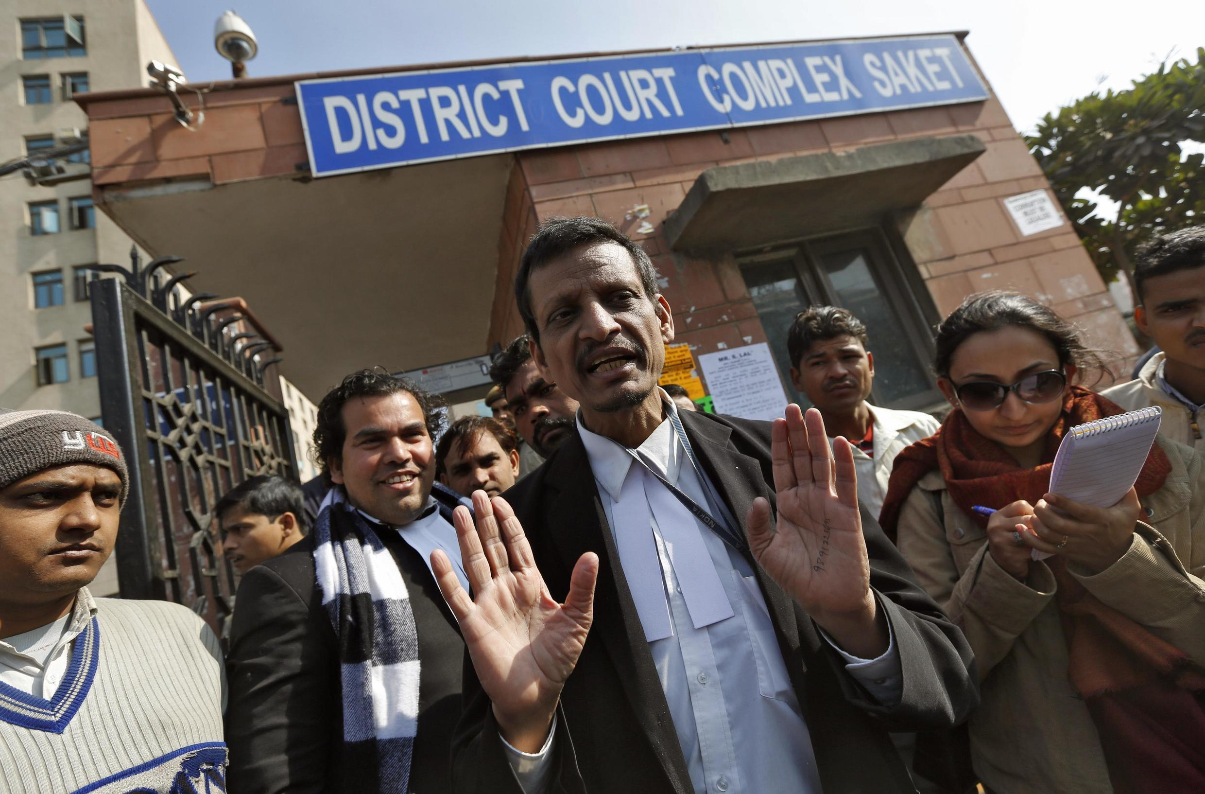 Manohar Lal Sharma (C), lawyer of one of the accused Mukesh Singh, speaks with the media outside a district court in New Delhi