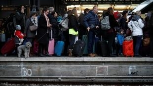 Commuters walk on a platform at Gare de l'Est train station as French transportation workers' strike continues for a 19th day on 23 December, 2019
