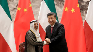 Kuwait's Emir Sheikh Sabah Al-Ahmad Al- Jaber Al-Sabah, left, shakes hands with Chinese President Xi Jinping after witnessing a signing ceremony at the Great Hall of the People in Beijing, China, July 9, 2018.