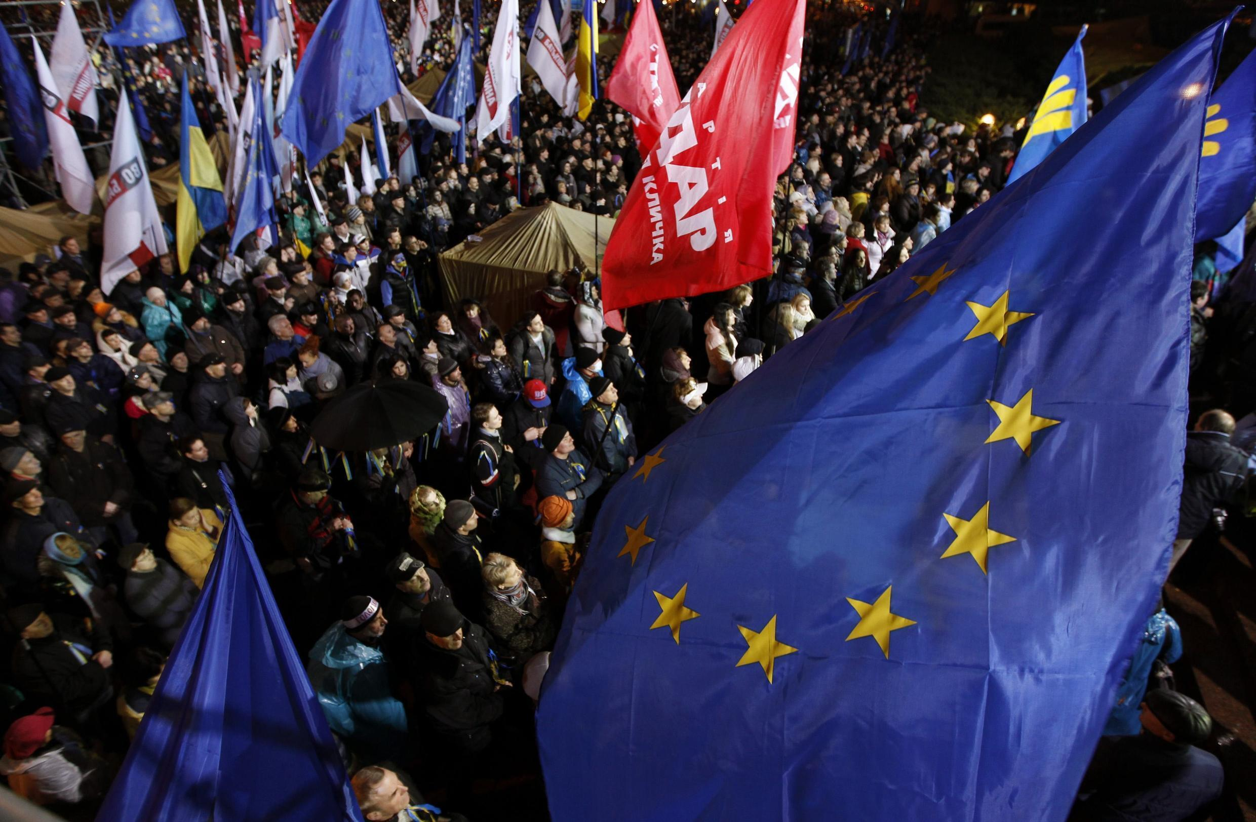 People attend a meeting to support EU integration at European square in Kiev, 25 November 2013