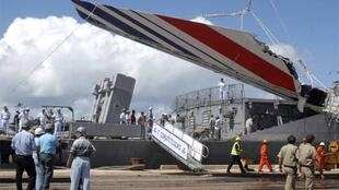 Debris of the missing Air France flight 447, recovered from the Atlantic Ocean, arrives at Recife's in June 2009